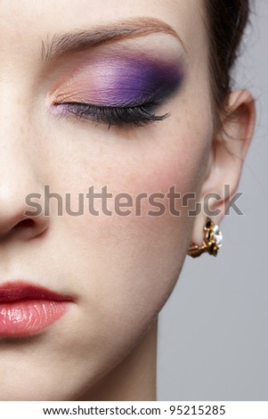 close-up half-face portrait of young beautiful woman with eyes closed - stock photo