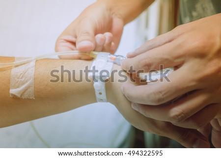 Close Hand Adjust Saline Iv Drip Stock Photo 494322595