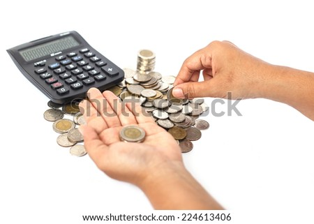 Close up hand count the coin with calculator isolated on white background - stock photo
