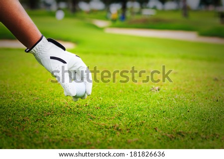 Close-up hand hold golf ball - stock photo