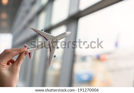 Close up hand holding an airplane model - stock photo