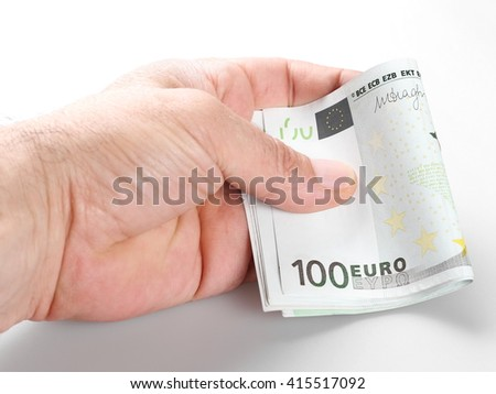 close up hand holding 100 euro bill isolated on white background - stock photo