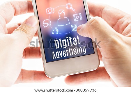 Close up hand holding mobile with Digital Advertising and icons, Digital Marketing concept. - stock photo
