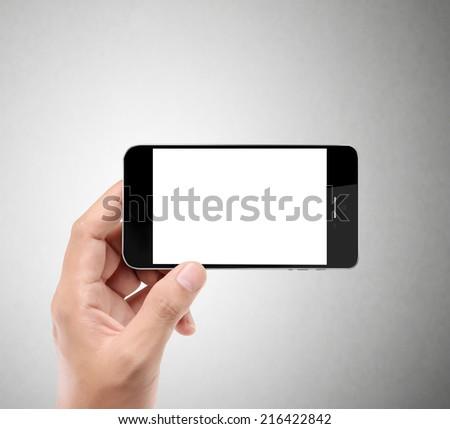 Close up hand holding smart phone - stock photo