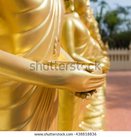 Close up Hand of Buddha statue in Thailand. - stock photo