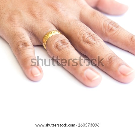 Close up hand with golden ring isolated on white background - stock photo