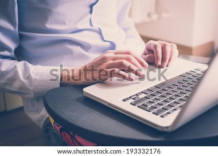 close up hands multitasking man using  laptop  connecting wifi - stock photo