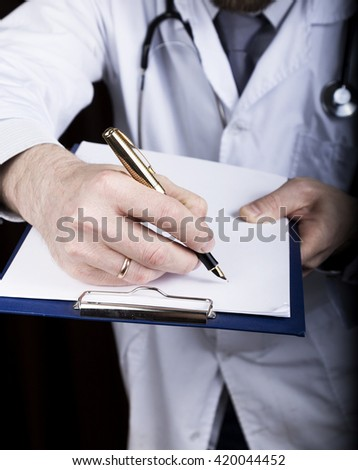 close-up hands of a medical doctor, the doctor signs a handle documents. Doctor writes medical history. write a prescription patient data history - stock photo