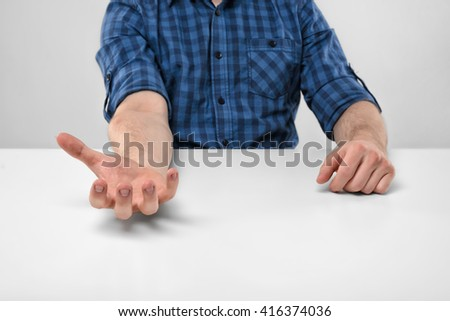 Close-up hands of man holding something in his palm. Palm up. Symbols and gestures. Body language. Hand gesture. Willingness to cooperate. Imitation. - stock photo