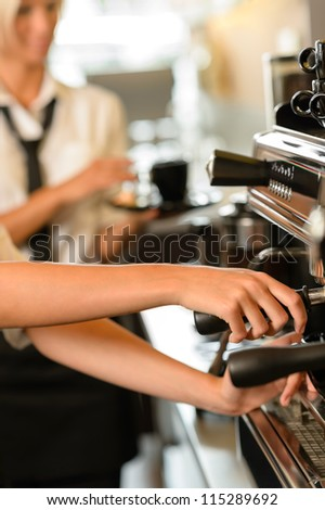 Close up hands waitress make coffee at work espresso machine - stock photo
