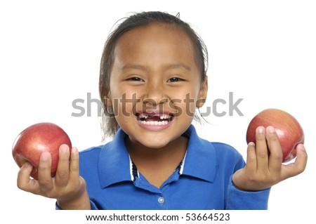Close up happy child with apple - stock photo