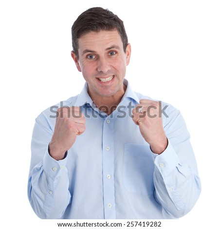 Close up Happy Handsome Businessman, in Light Blue Long Sleeve Shirt, Clenching his Fists for Success While Looking at the Camera. Isolated on a White Background. - stock photo