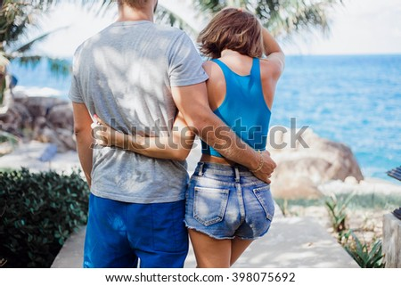 Close up happy hire couple.Young friends funny guys active people have fun together woman and man, girl and guy summer urban casual style. Pink brick wall, spring outfit. - stock photo