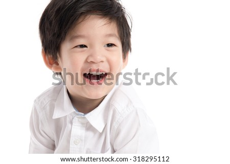 Close up happy little asian boy on white background isolated - stock photo