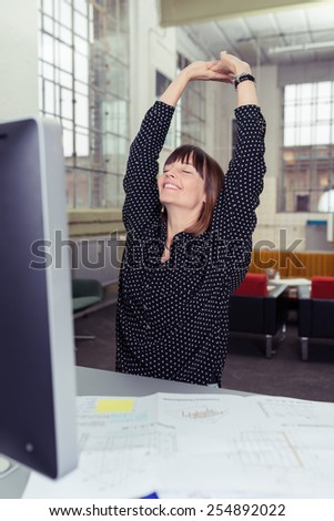 Close up Happy Woman Stretching her Arms After Work at her Worktable. - stock photo