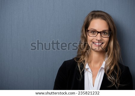 Close up Happy Young Businesswoman with Blond Hair on Gray Background with Copy Space on Left Side While Looking at the Camera. - stock photo