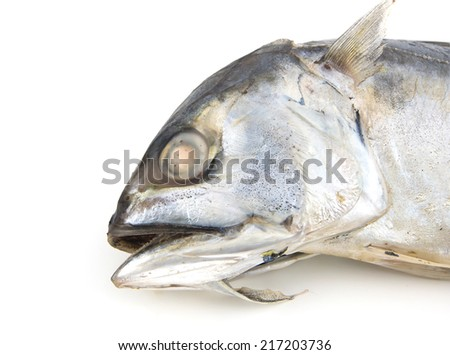 Close up Head Mackerel fish in bamboo basket Isolated on white