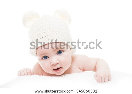 Close up head shot of a caucasian baby boy.Baby wearing a knit hat with bear ears.Blue eyed baby with white hat - stock photo