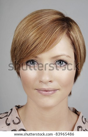 close up head shot of a young good looking woman - stock photo