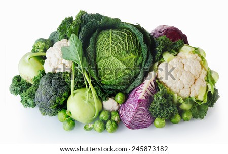 Close up Healthy Fresh Farm Vegetables Isolated on White Background. Emphasizing Cabbage, Broccoli, Cauliflower and Brussels Sprout. - stock photo