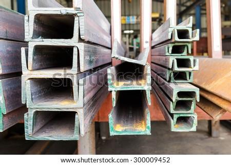 Close up heap of U shape beam steel in factory shelf - stock photo