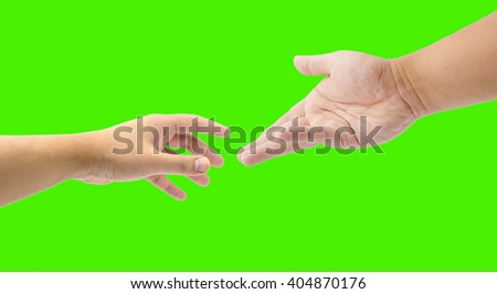 close up helping hand on green screen - stock photo