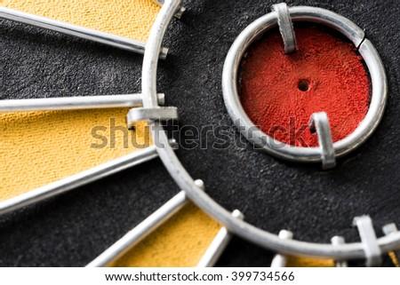 Close up hole in bullseye target on dartboard - stock photo