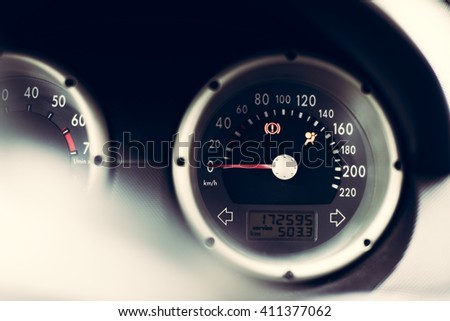 close up horizontal image of a round vehicle speedometer with black frame showing that the vehicle is in starting position - stock photo