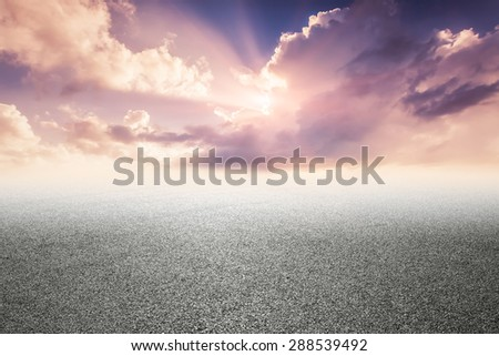 close-up horizontal view of new asphalt road - stock photo