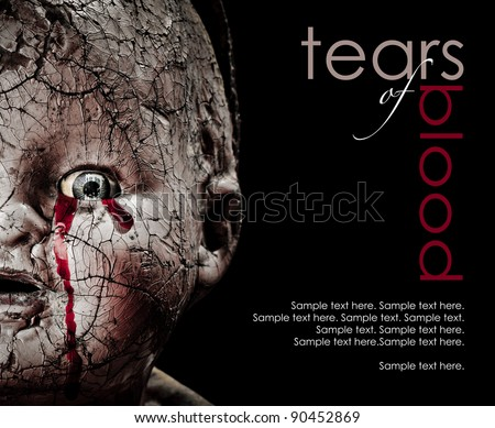 Close up Horror photo of a Cracked Scary Doll Crying Blood with text space to the right - stock photo