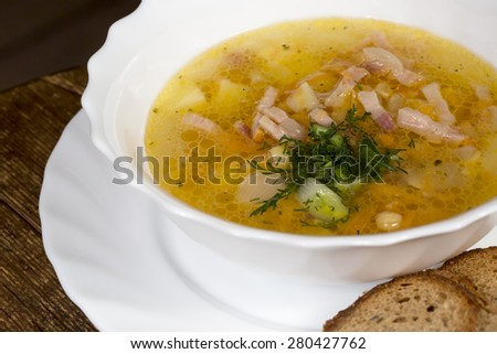 Close up hot soup with meat and toast