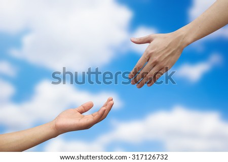 close up human hand helping/praying hand on blurred vivid sunny sky background,support/aid/love/trust concept.healthcare/therapy/heal conceptual ideal.kindness/compassion/affection:friend and family - stock photo