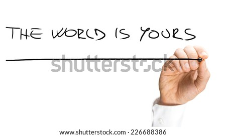 Close up Human Hand Writing Underlined The World is Yours Texts on White Background. A Simple Business Concept Design. - stock photo