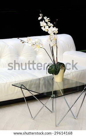 Close up image, detail, of modern living room interior with armchair
