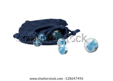 Close-up image of a bag full of marbles against the white background - stock photo