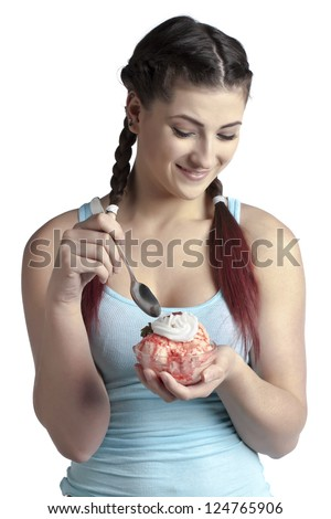 Close-up image of a beautiful woman eating ice cream over the white surface - stock photo