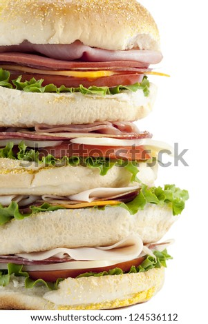 Close-up image of a big pile of ham sandwich isolated on a white background