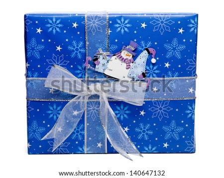 Close-up image of a blue Christmas gift box with snowman sticker isolated over white background. - stock photo