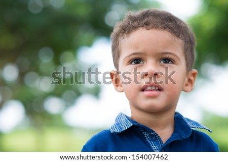 Close-up image of a cute little boy in the park - stock photo