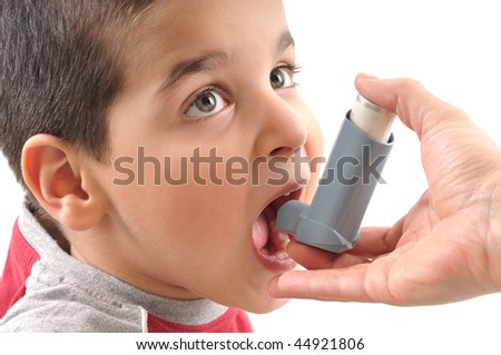 Close up image of a cute little boy ready to use inhaler for asthma from his mothers hand. White background studio picture. - stock photo