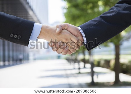 Close-up image of a firm handshake  - stock photo