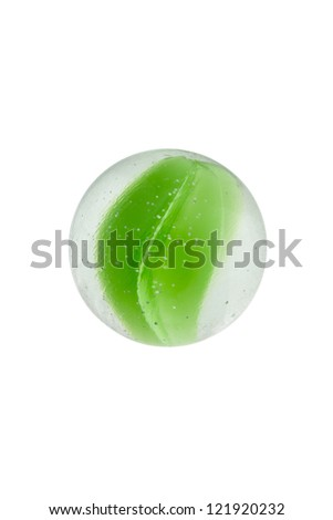 Close-up image of a green glass marble against the white background