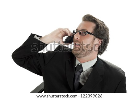 Close-up image of a handsome businessman talking on the cellphone looking away on the white background