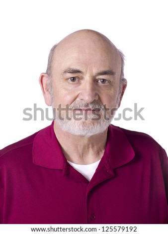 Close-up image of a healthy old man wearing a red polo shirt smiling while looking to the camera - stock photo