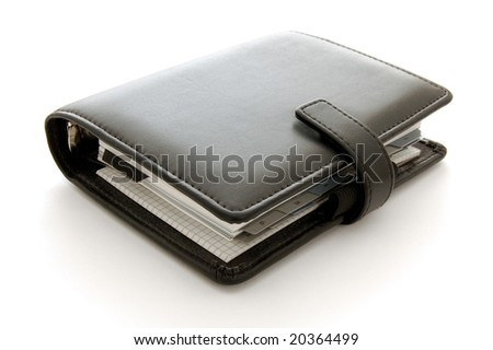 Close up image of a leather personal organiser on a white background - stock photo
