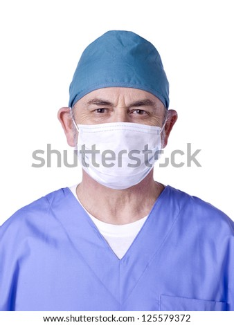 Close-up image of a male doctor wearing a face mask against the white background - stock photo