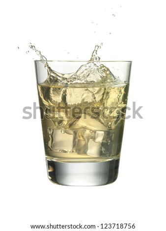 Close-up image of a martini drink with a splash in a white background - stock photo
