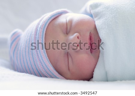 Close-up image of a one-day old baby boy - stock photo