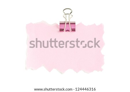 Close-up image of a pink paper and paper clip against the white background - stock photo