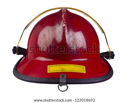 Close-up image of a red head gear of a fireman over the white background - stock photo